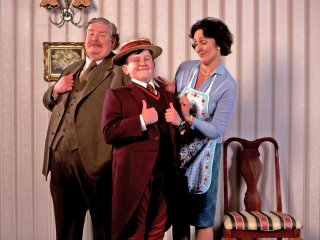 The Dursley family photo, Dudley is wearing his Smeltings school uniform