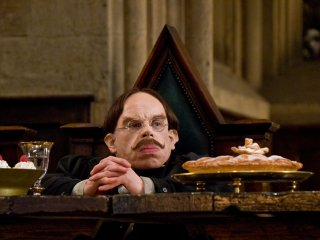Flitwick sitting at the teachers table