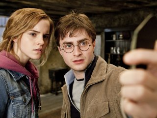 Harry and Hermione looking into the broken mirror shard