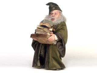 Flitwick carrying on a stack of books