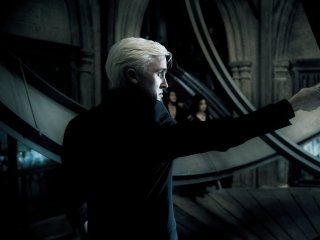 Draco Malfoy attempts to attack Dumbledore under Lord Voldemort's instruction.