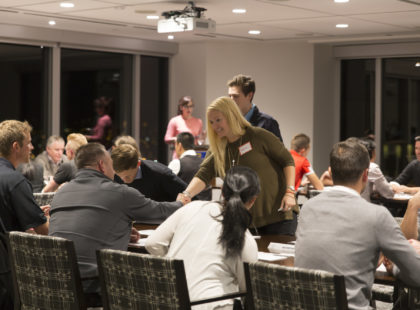 Photo of athletes getting seated at alumni networking session