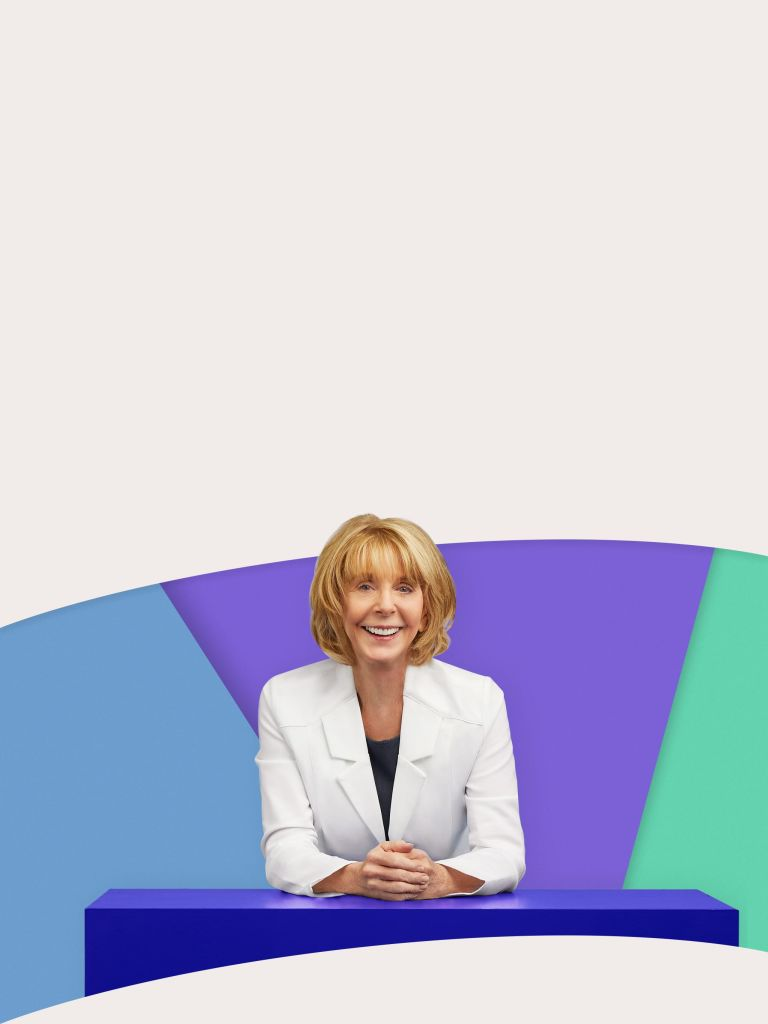 Mature female physician on colored shape background