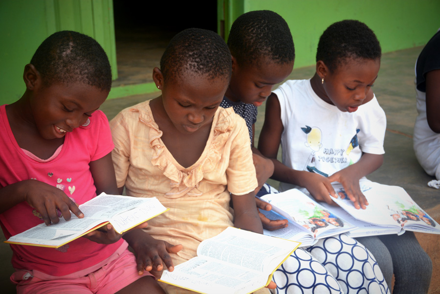 Girls reading Bible in Ghana