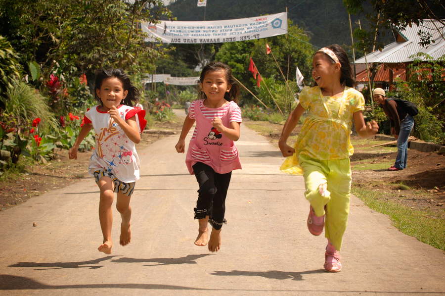 Girls running in Indonesia