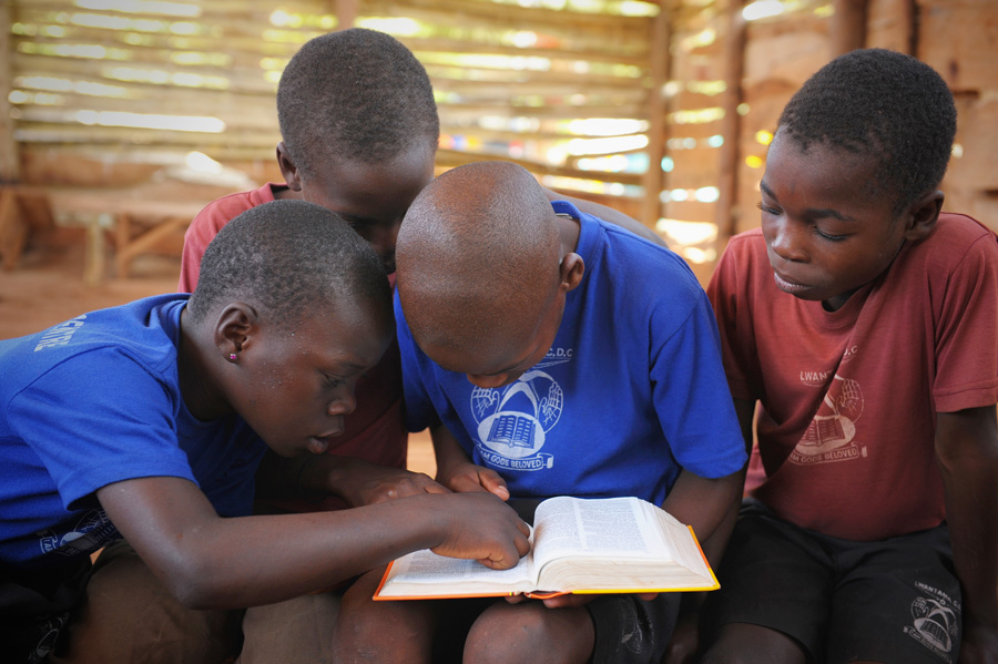 Children reading Uganda