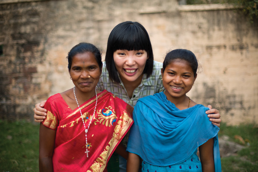 Dami Im visiting her sponsored children