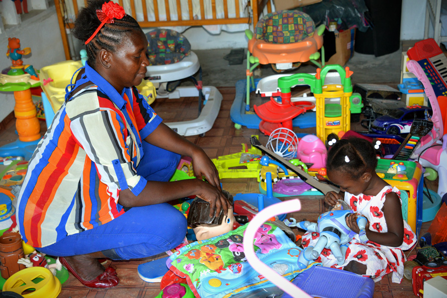 Gertrude and daughter playing at Compassion centre