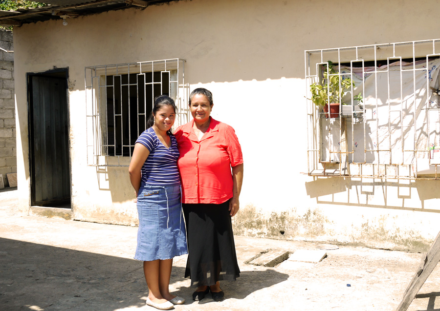 Naomi and Blanca outside their home
