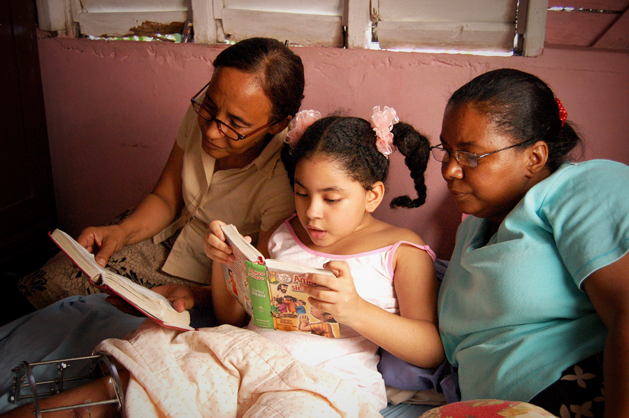 Family reading Dominican Republic