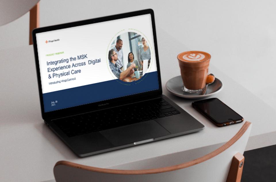 Laptop displaying the a webinar