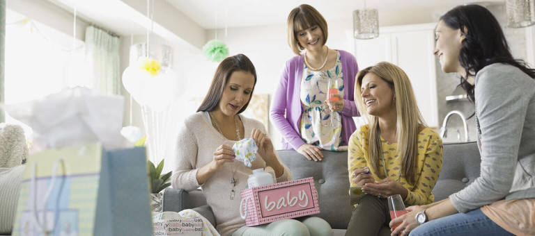 Baby shower: mom-to-be and guests having fun