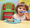 Toddler-eating--with-mum-encouraging