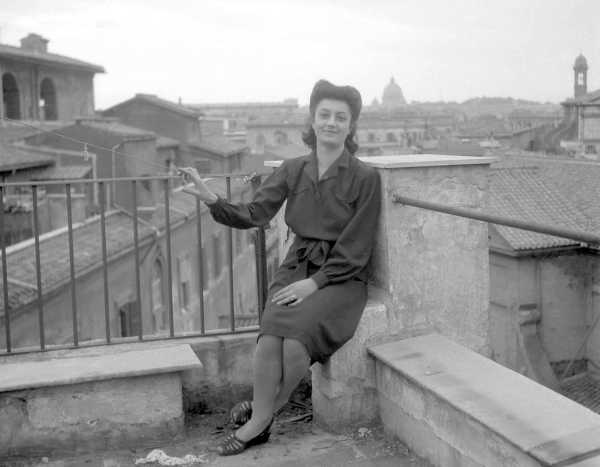 Woman Sitting on Balcony