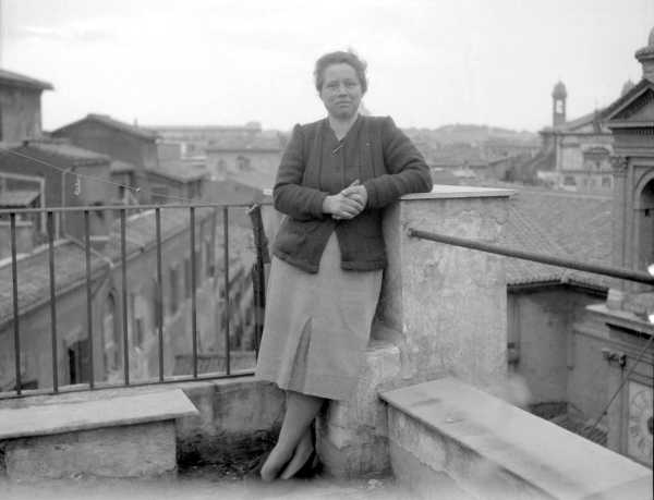 Woman Standing on Balcony