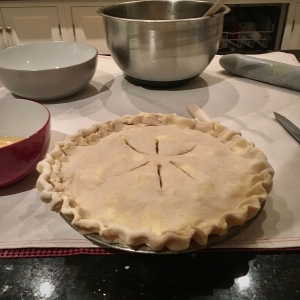 An apple pie ready to be baked