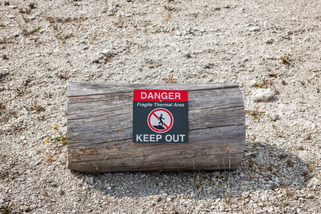 Danger Keep Out Sign in Yellowstone - Shutterstock