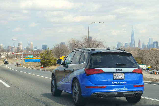 automated-driving-car-on-highway-with-new-york-city-background.jpg