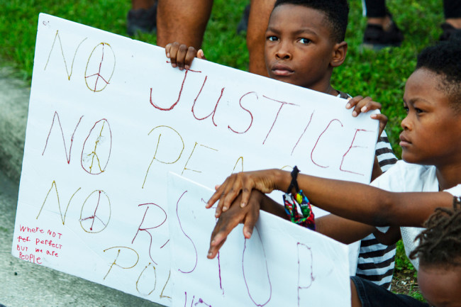 protest child sign racism - shutterstock