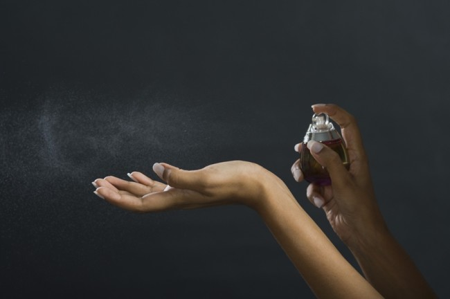Applying Perfume to Wrist - Shutterstock