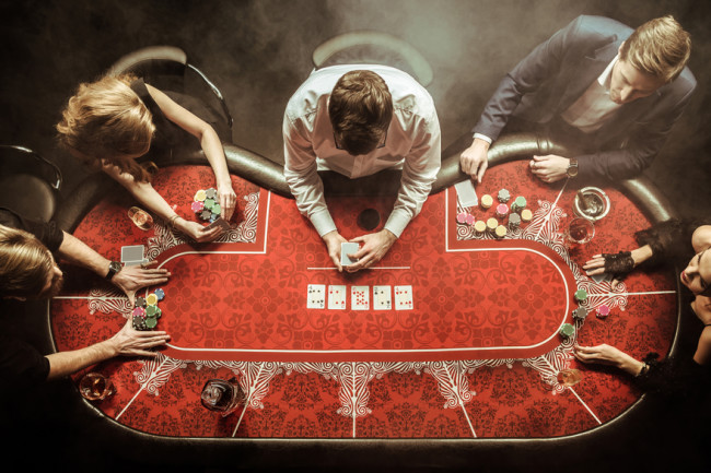 Playing Poker - Shutterstock