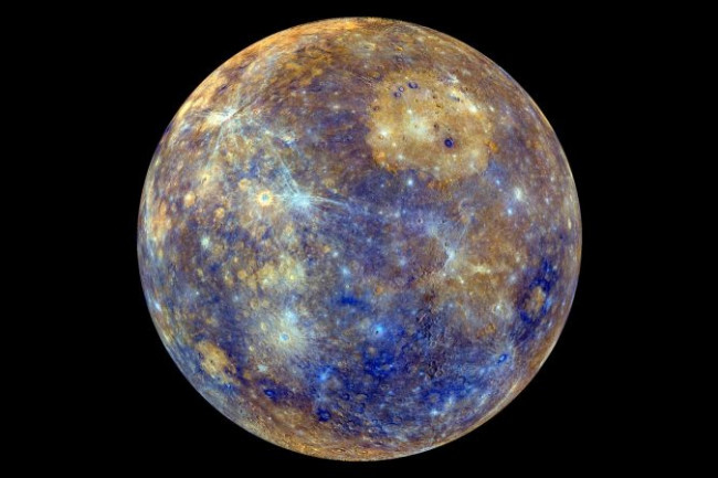 Mercury in false color, to visually enhance the chemical, mineralogical and physical differences between the rocks that make up Mercury's surface. Image via NASA/JHU-APL/Carnegie Institution of Washington.