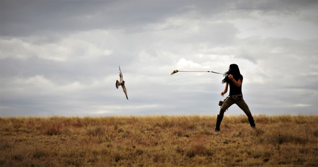 Kalen Pearson, CEO of Skywolf Inc, lure-flying with one of her falcons