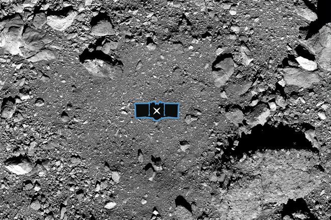 NASA's OSIRIS-REx probe slammed into asteroid Bennu in October, grabbing a sample of the rocky surface. The outline indicates the relative size of the probe. (Credit: NASA-GSFC/University of Arizona)