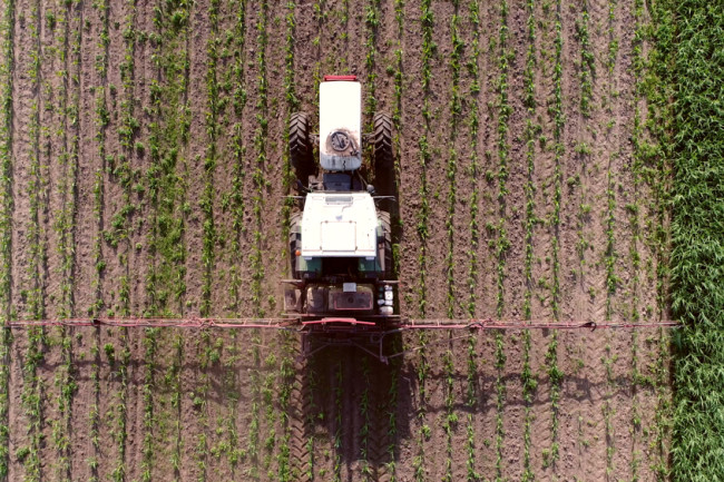 Tractor Herbicide Glyphosate Round-Up Farm Agriculture - Shutterstock