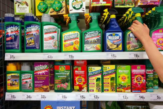 Shelves of Herbicide Pesticide Roundup - Shutterstock