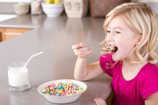 Girl Child Eating Sugar Cereal Fruit Loops Breakfast - Shutterstock