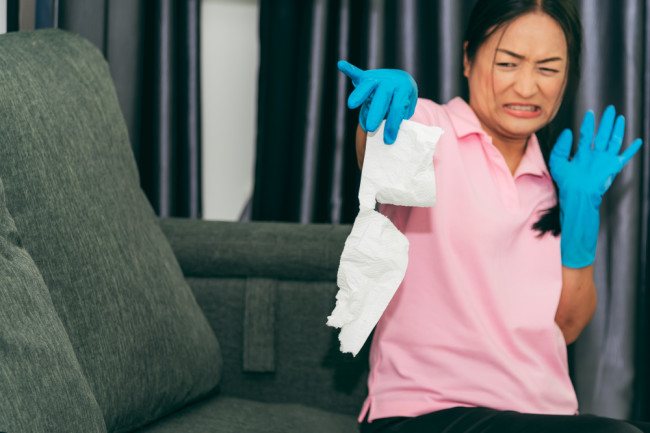 woman disgusted tissue - shutterstock