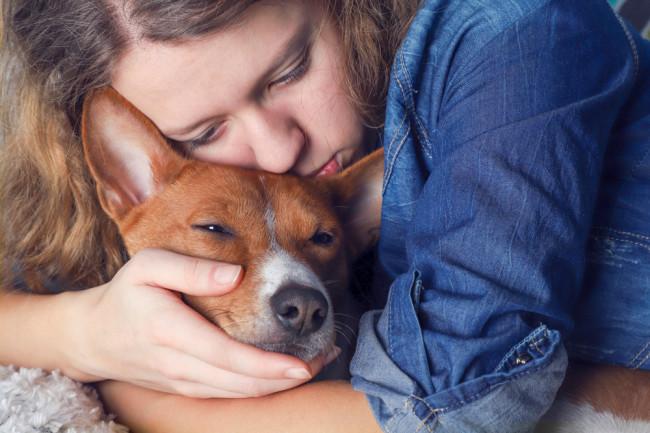 Sad Human with Dog - Shutterstock