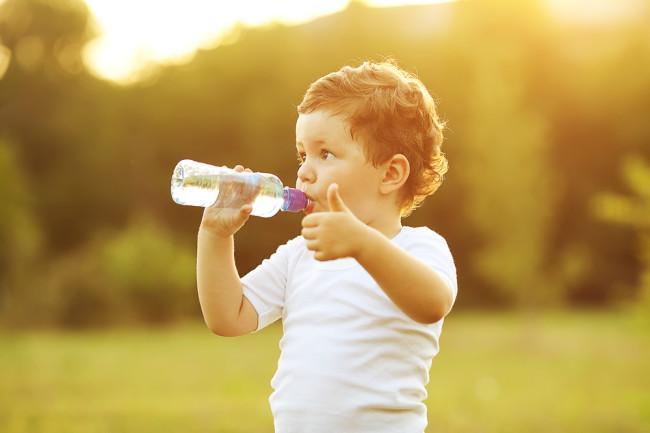 Kid Drinking Plastic Water Bottle - Shutterstock