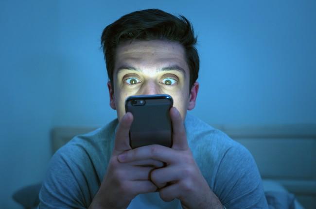 Man on Phone - Shutterstock