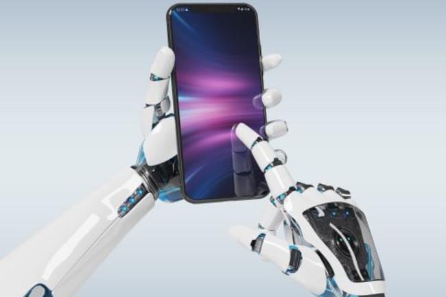 Robot hands using smartphone - Shutterstock