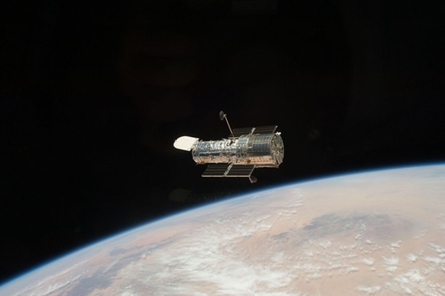 Hubble Space Telescope floates above Earth