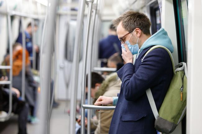 man coronavirus mask public transportation - shutterstock