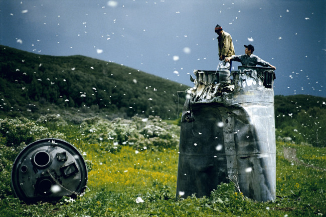 Villagers collecting scrap from a crashed spacecraft, surrounded by thousands of white butterflies. Environmentalists fear for the region's future due to the toxic rocket fuel. (Credit: Jonas Bendiksen/Magnum)