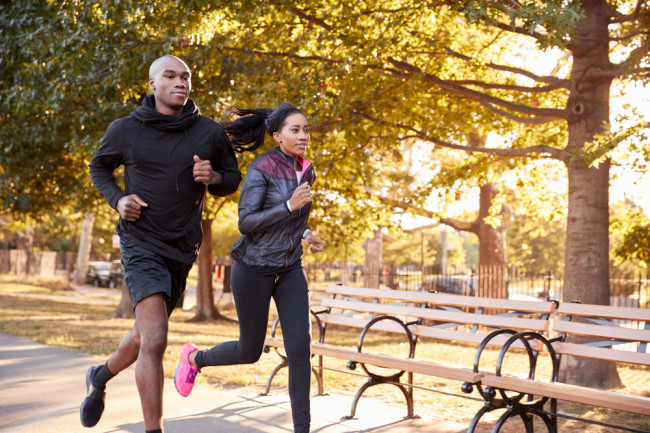 a young couple jogging in brooklyn - shutterstock