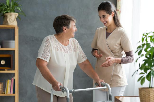 Parkinson's Disease, Woman with Walker - Shutterstock