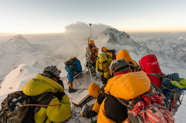 Baker Perry (along with Tom Matthews and a team of Sherpa guides) set up their weather station at the Balcony on Mount Everest. (Credit: National Geographic Society/Mark Fisher)