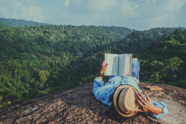 book reader mountains - shutterstock