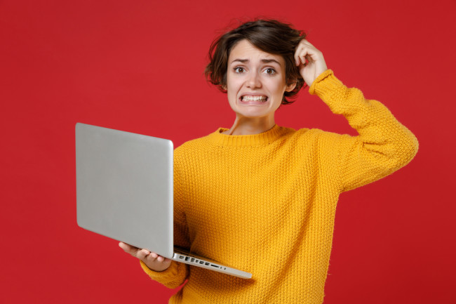 woman worried computer - shutterstock