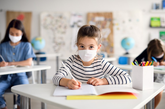 Back to School, Child in Face Mask in Classroom, COVID-19 - Shutterstock