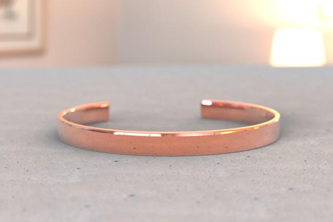 Copper bracelet pain on a table - shutterstock