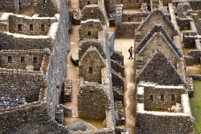 A man wanders through the ruins of Machu Picchu. (Credit: Russell Johnson/Shutterstock)
