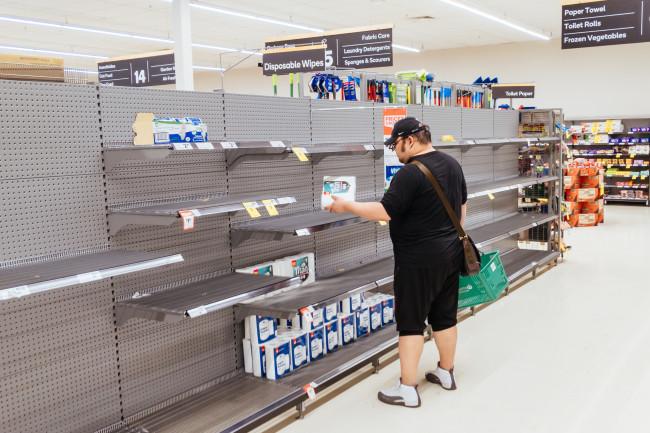 shopper coronavirus empty shelves - Shutterstock
