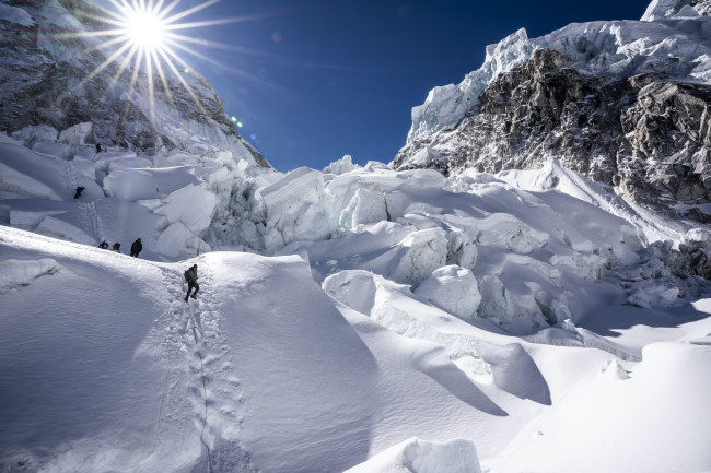 Look Ma, top of the world! Climbers with the Perpetual Planet Everest Expedition brave the Khumbu Icefall, a treacherous section along the route to Everest's summit. (Credit: National Geographic Society/Mark Fisher)