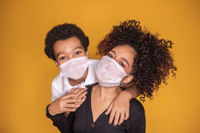 covid-19 coronavirus pandemic parent immunity mask - shutterstock